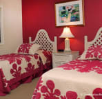 Sleep under authentic Hawaiian quilts on twin beds which together make a king.