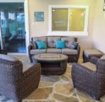Comfortable sitting area on the lanai; great for relaxing and enjoying company.
