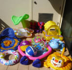 Lots of kids beach gear including floats for babies and young kids