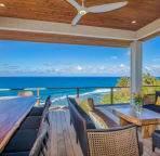 Outside covered living and dining above the reef