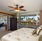 Spacious master bedroom closes off with elegant shoji doors