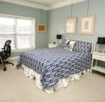 Master Bedroom with Queen bed and desk.
