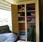 Lanai cabinet with beach supplies