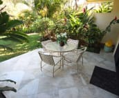 The 144 sq ft. lanai is tiled in for your enjoyment.