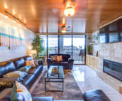 Lounge with leather sofas seating 7. Includes widescreen cable TV and fireplace.