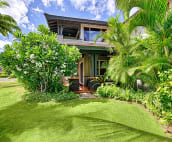 Back view of villa and plumeria tree on a typical sunny day on the Big Island.