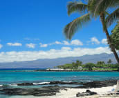 View from beach club toward the Mauna Lani Bay and Bungalow Hotel.