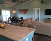 The large dining table easily seats 10 and there is seating for 4 at the kitchen island.