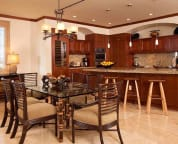 Dining seat 6, plus more seating at kitchen island bar - sample villa