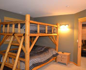 One of two queen bunk beds in basement.