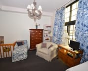 Large bedroom in the suite also has a fold out chair bed and a fold out ottoman bed