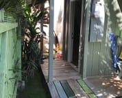 Front door leads up