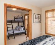 Bedroom 2 & 3 separated by wood pocket doors.