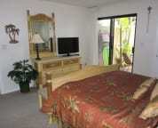 Master Bedroom w/King Bed & Dresser Including LCD TV w/Private Courtyard Access