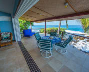 "The ""disappearing"" wall between the living room and lanai is outdoor living at its best."