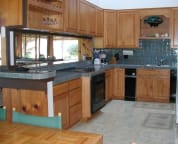 Gourmet kitchen and breakfast bar, with custom tile counters