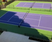 Professional tennis courts built Dec 2014; conveniently located steps away from our building
