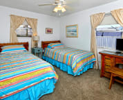 3rd bedroom with 2 twin size beds and flat screen TV