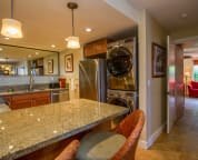 Fully equipped kitchen with stainless steel appliances, granite counters