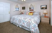 master bedroom with extremely comfortable king size bed and flat screen TV