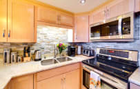 Executive kitchen with stainless steel appliances including double fridge.