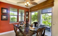 Morning Glory's tastefully decorated dining room leads to a wrap around lanai with built in Viking BBQ.