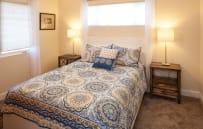Queen bedroom upstairs with smart tv