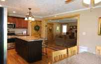 Alternate view of Kitchen from eat in area looking into Family Room.  The open concept floor plan everyone loves.