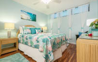 Soothing island colors. Queen bed with memory foam topper.