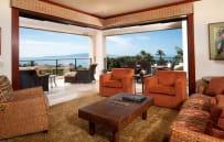 Living room and spacious corner unit deck and panoramic ocean view