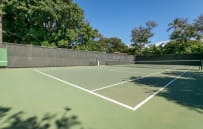 Private tennis court with available equipment rental.