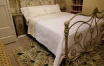 Queen size bed with quality linens in the main apartment