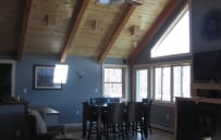 The dining room side of the great room has access to the wrap around deck.