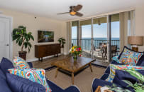 Comfy renovated living room (new smart tv too!) overlooking the Gulf.