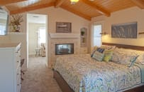 Master bedroom with king size bed and smart tv
