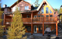 Exterior with larch. Hot tub on upper back deck.
