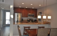 Newly updated kitchen with granite counters and stainless appliances. Open to dining area and family room.