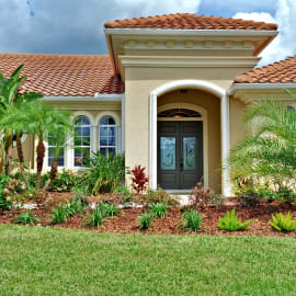 Front Of House - Meticulously Landscaped Yard