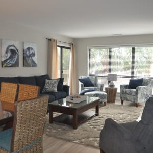 Newly decorated open concept living-dining room with beachy theme, 55 inch flat screen TV (with cable and Netflix) and ample seating.