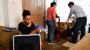 A CU student and researcher enter the home of a study particpant and begin to ask her questions about her family's experience with episodes of asthma.