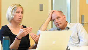A physician listens to an environmental engineer speak during a group discussion about the study.