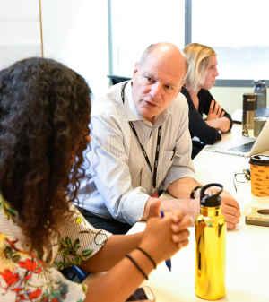 Fernando Holguin, MD, talks to a female CU student
