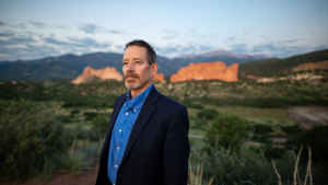 """Professor Charles """"Chip"""" Benight stands in the Garden of the Gods park in Colorado Springs facing east"""