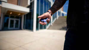 A veteran holds a fidget spinner in his right palm, which he uses when he is feeling anxious.