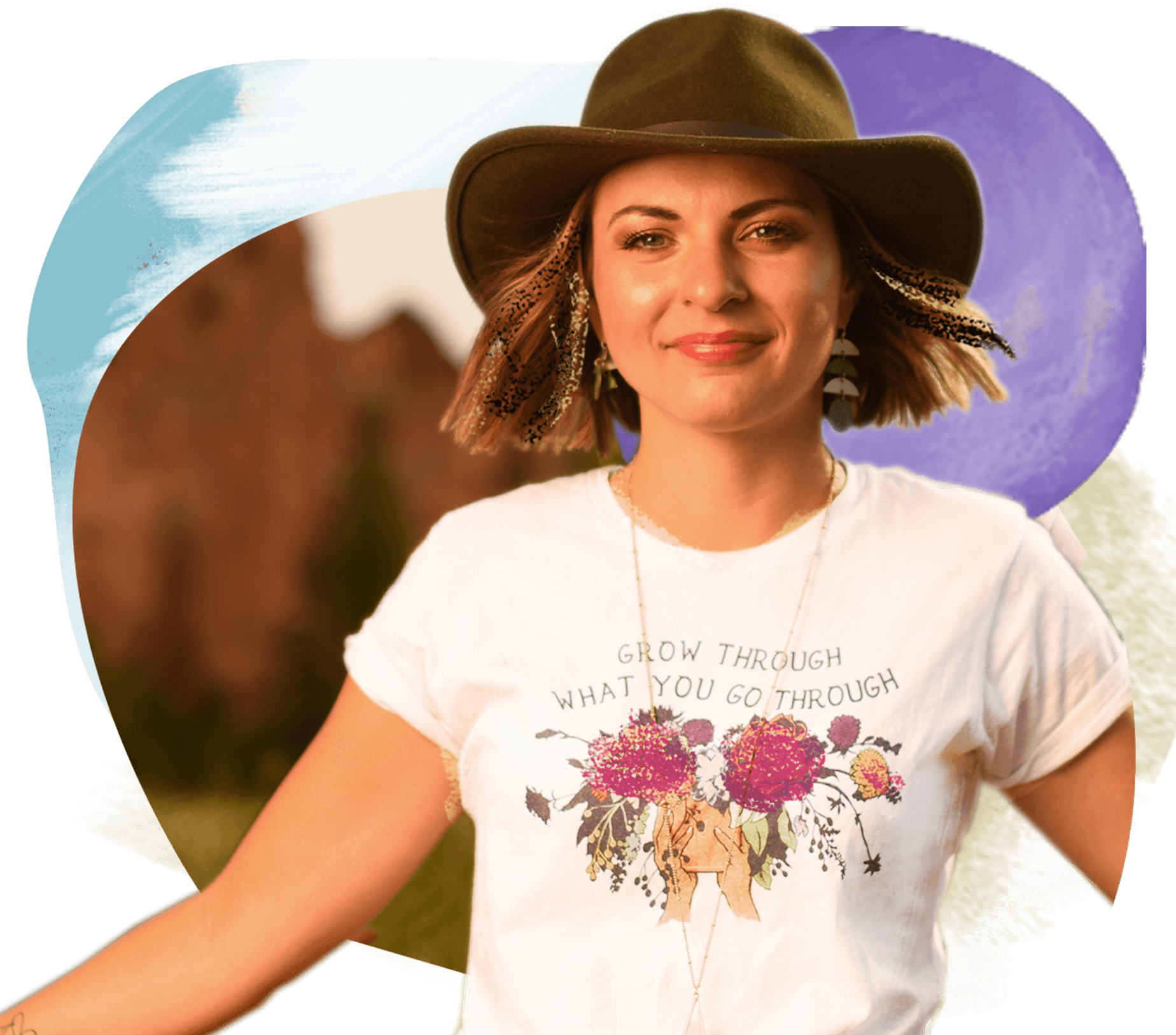 "A young woman with chin-length brown hair wears a brown fedora and a white T-shirt that says ""Grow through what you go through"" above a floral design. The background is an artistic design with colorful shapes."