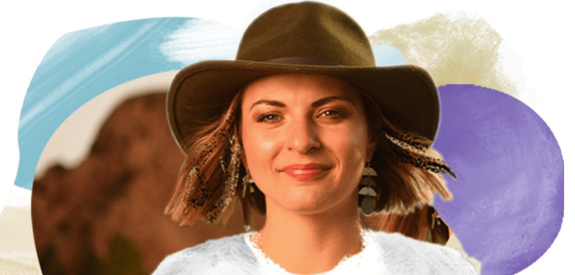 """A young woman with chin-length brown hair wears a brown fedora and a white T-shirt that says """"Grow through what you go through"""" above a floral design. The background is an artistic design with colorful shapes."""