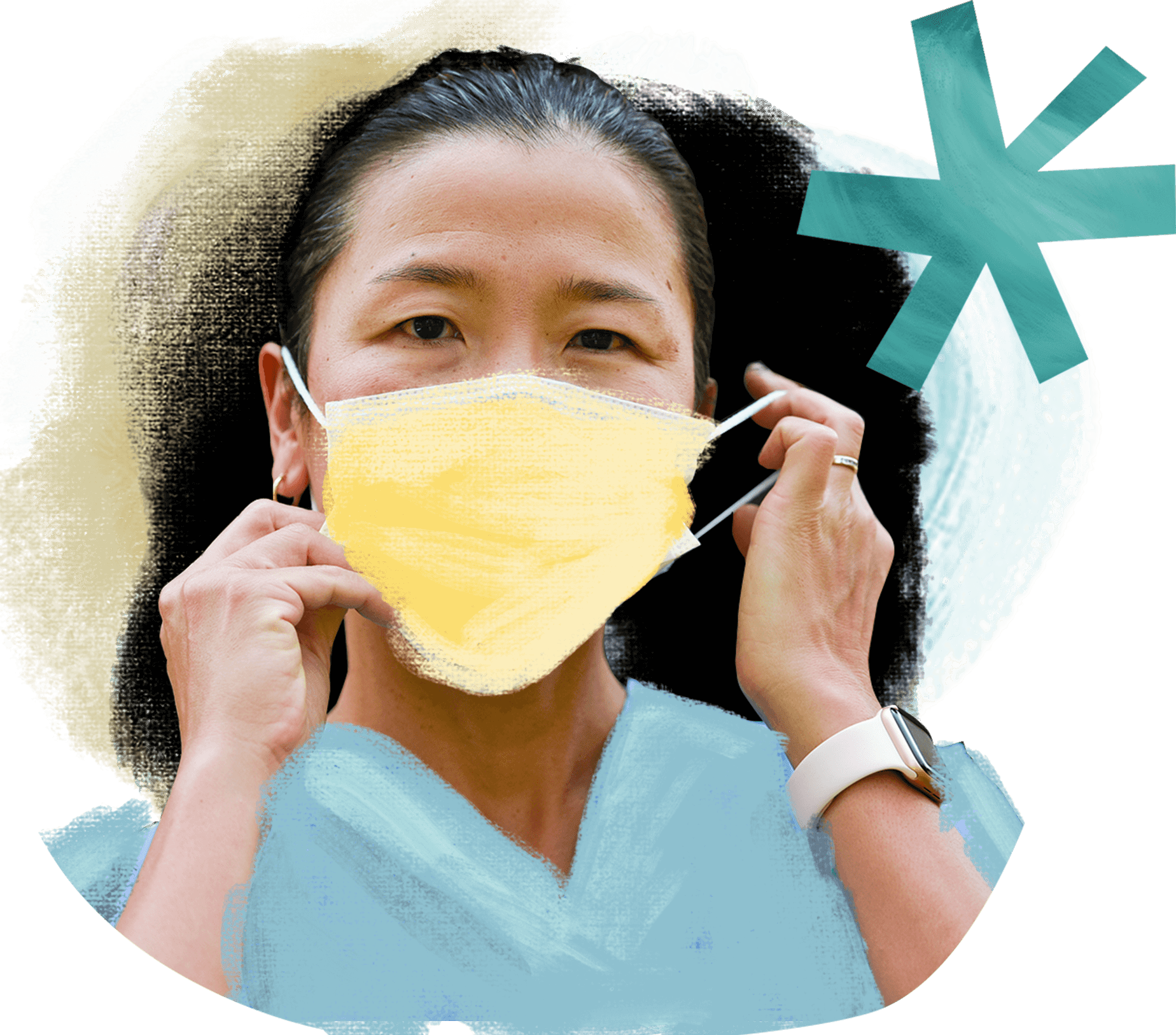 A woman wears medical scrubs and put on a yellow medical mask.