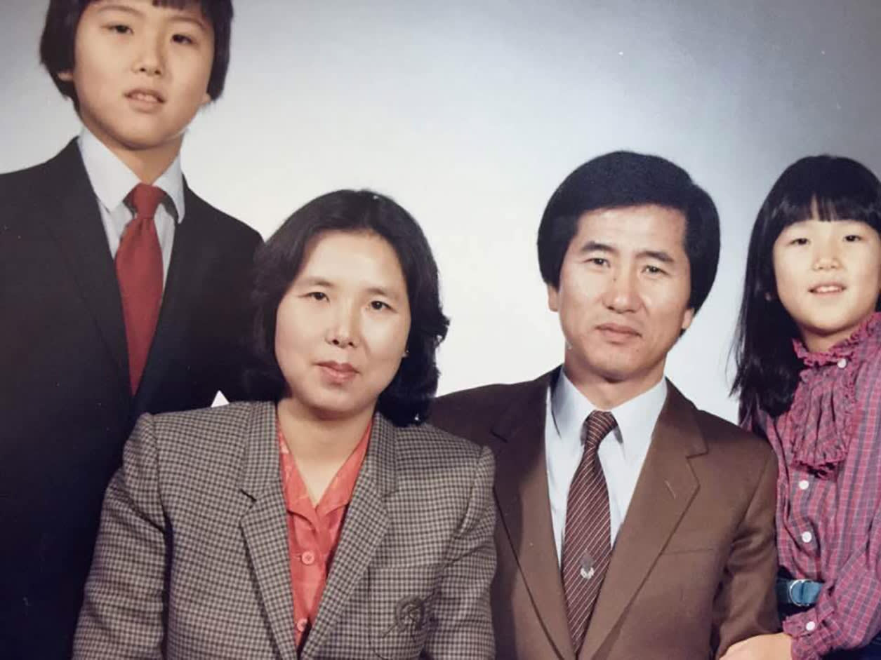 "A family portrait of Sunah ""Susan"" Hwang, MD as a young child with her brother and parents."