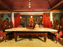 Dine like a Balinese King in an Antique-filled Room