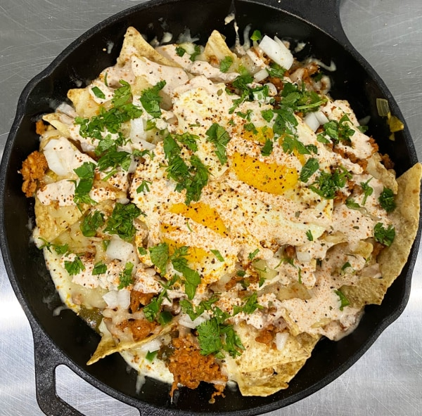 Image ofChorizo Chilaquiles Verdes with Crema